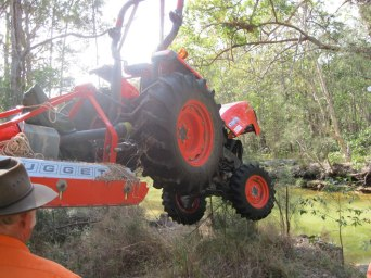 We bought a Crane into lift the tractor out and over the mangroves